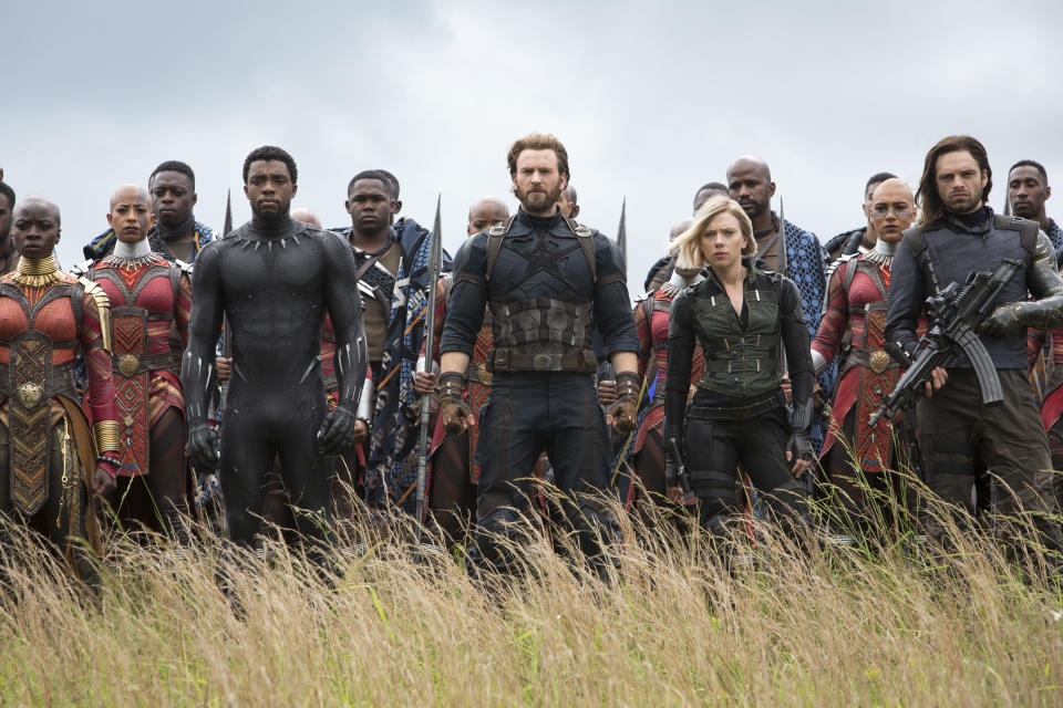 """This image released by Marvel Studios shows, front row from left, Danai Gurira, Chadwick Boseman, Chris Evans, Scarlet Johansson and Sebastian Stan in a scene from """"Avengers: Infinity War."""" (Chuck Zlotnick/Marvel Studios via AP)"""