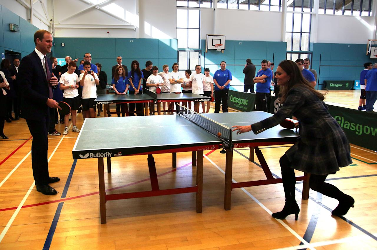 William and Kate (who was pregnant with Prince George at the time) show off their table tennis skills in Glasgow in April 2013.<em> [Photo: PA]</em>