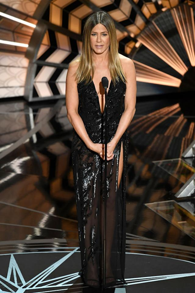<p>Jennifer Aniston's Atelier Versace gown showed a lot of leg with a high slit (Angelina Jolie style, maybe?) and a sheer skirt with beaded detailing.<em>(Photo: Getty Images)</em> </p>