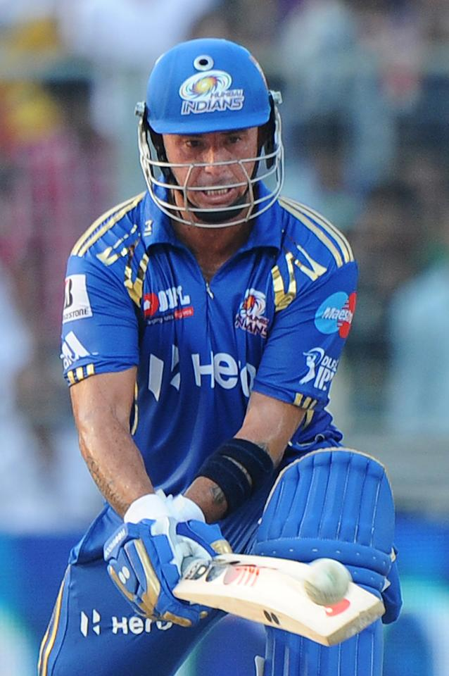 Mumbai Indians batsman Herschelle Gibbs plays a shot during the IPL Twenty20 cricket match between Kolkata Knight Riders and Mumbai Indians at The Eden Gardens in Kolkata on May 12, 2012.  RESTRICTED TO EDITORIAL USE. MOBILE USE WITHIN NEWS PACKAGE.  AFP PHOTO/Dibyangshu SARKAR        (Photo credit should read DIBYANGSHU SARKAR/AFP/GettyImages)