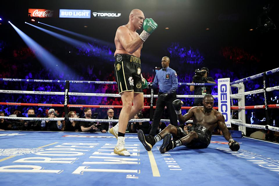 Tyson Fury knocks down Deontay Wilder in the fifth round during their Heavyweight bout for Wilder's WBC and Fury's lineal heavyweight title on February 22, 2020.
