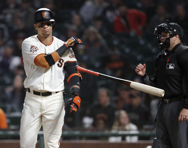 San Francisco Giants' Gorkys Hernandez throws his bat after striking out against the Atlanta Braves during the first inning of a baseball game in San Francisco, Tuesday, Sept. 11, 2018. (AP Photo/Tony Avelar)