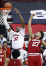 Ohio State forward E.J. Liddell, left, reaches for a rebound against Indiana forward Trayce Jackson-Davis during the second half of an NCAA college basketball game in Columbus, Ohio, Saturday, Feb. 13, 2021. Ohio State won 78-59. (AP Photo/Paul Vernon)