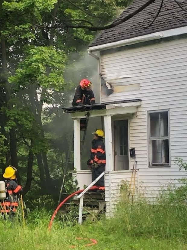 New Glasgow has dealt with a rash of suspicious fires over the last 18 months, including one at this vacant residence. A woman has been charged with nine counts of arson and three cases of mischief in connection to fires in the area. (New Glasgow Regional Police - image credit)