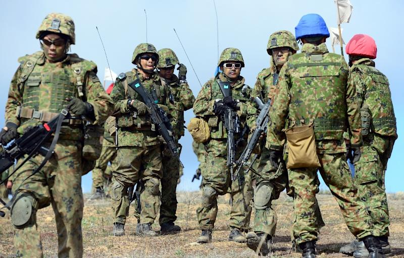 Soldiers from the Japan Ground Self-Defense Force's Western Army Infantry Regiment await instructions during a joint-exercise with US Marines, during Exercise Iron Fist, at Camp Pendleton in southern California, in February 2014 (AFP Photo/Frederic J. Brown)