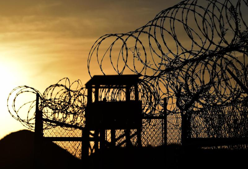 "Photo taken on April 09, 2014 and reviewed by the US military shows the razor wire-topped fence and a watch tower at the abandoned ""Camp X-Ray"" detention facility at the US Naval Station in Guantanamo Bay, Cuba during an escorted visit"