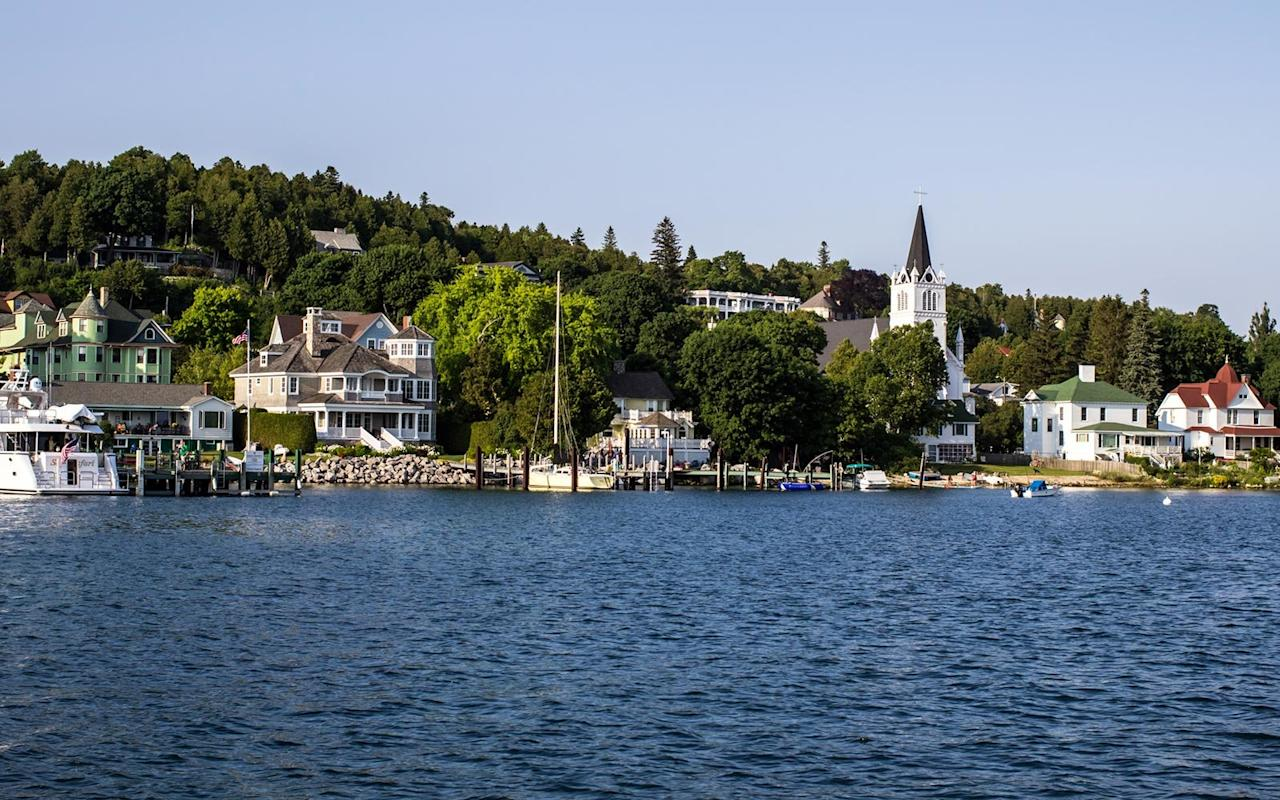 """<p>Arriving on <a href=""""https://www.mackinacisland.org"""" target=""""_blank"""">Mackinac Island</a> is like taking a step back in time — Victorian-era architecture, horse-drawn carriages, quaint cottages, and not a car in sight. The island has been preserved so well that if its early 19th-century summer vacationers returned today, they would feel right at home in this National Historic Landmark. June's mild weather in the 60s to low 70s is comfortable, and the season opens with the annual <a href=""""https://www.mackinacisland.org/mackinac-island-lilac-festival/"""" target=""""_blank"""">Lilac Festival</a>, celebrating the fragrant flowers with 10 days of events from June 7-16. Tours, a 5K run/walk, kite flying, lilac planting seminars, and a grand parade are on the 71st Annual Festival's agenda. An 8-mile bike trail circles the island, and there are hiking trails as well as walking and carriage tours. <a href=""""https://www.mackinacparks.com/parks-and-attractions/mackinac-island-state-park/"""" target=""""_blank"""">Mackinac Island State Park</a> covers about 80 percent of the island, and includes monuments, historic sites, and a Native American cultural history trail. Visitors arrive at the island via ferry on <a href=""""https://www.sheplersferry.com/"""" target=""""_blank"""">Shepler's</a> or <a href=""""https://www.mackinacferry.com"""" target=""""_blank"""">Mackinac Island Ferry</a> from Mackinaw City or St. Ignace. Hotels, resorts, B&Bs, and cottages provide a range of lodging for the island's visitors. <a href=""""https://www.missionpoint.com"""" target=""""_blank"""">The Mission Point Resort,</a> set on 18 acres along Lake Huron's waterfront, offers a spa, fitness center, pool, 18-hole putting course, bike rentals, and five dining options including a wine bar, a casual outdoor spot, and an Italian restaurant. Be sure to pronounce Mackinac correctly: It's <em>MACK-in-aw</em>. Mackinaw City is spelled with the <i>aw</i> ending, but both the island and city are pronounced the same.</p>"""