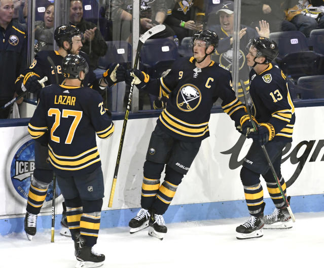 Buffalo Sabres' Jack Eichel (9) is congratulated by teammates Curtis Lazar (27) and Jimmy Vesey (13) after he scored the winning goal in an NHL preseason hockey game against the Pittsburgh Penguins, Monday, Sept.16, 2019, in State College, Pa. (AP Photo/John Beale)