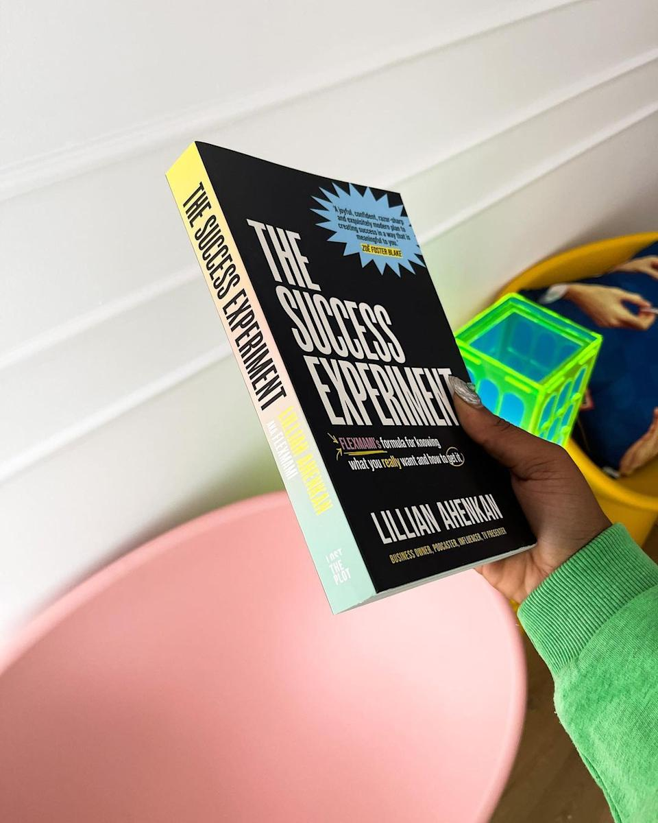 Lillian Ahenkan holding a copy of her book, The Success Experiment. Photo: Instagram/flex.mami.