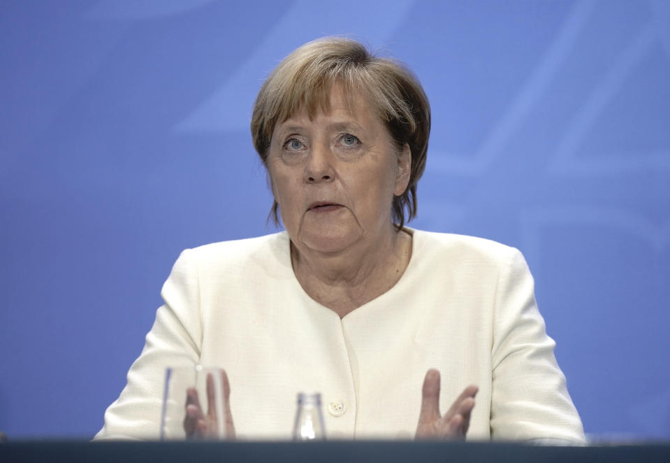 German Chancellor Angela Merkel takes part in a coronavirus press conference, in Berlin, Tuesday, Sept. 29, 2020. Chancellor Angela Merkel and the governors of Germany's 16 states conferred on how to prevent the country's coronavirus infection figures from accelerating to the levels being seen in other European countries. (Kay Nietfeld/dpa via AP)