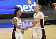 Stanford guard Kiana Williams (23) and Stanford forward Cameron Brink (22) react after scoring against Oregon State during the second half of an NCAA college basketball game in the semifinal round of the Pac-12 women's tournament Friday, March 5, 2021, in Las Vegas. (AP Photo/Isaac Brekken)