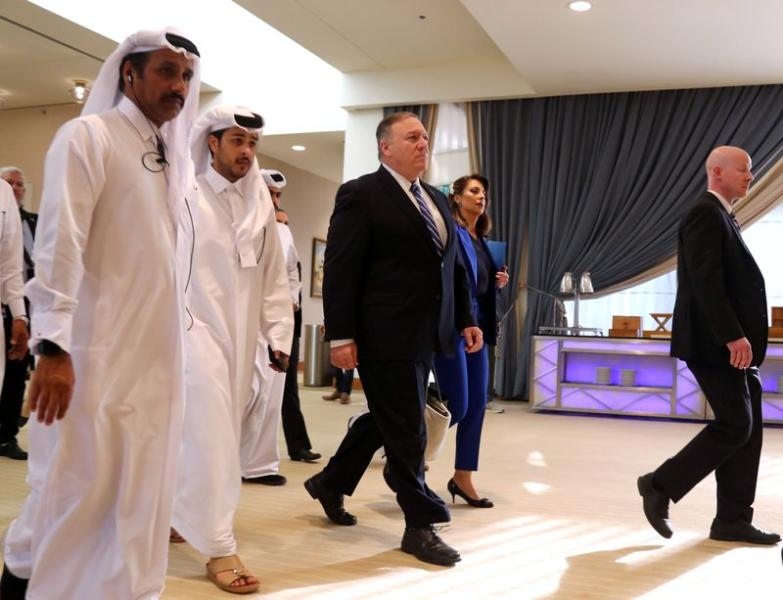 U.S. Secretary of State Pompeo walks ahead of the signing of an agreement between members of Afghanistan's Taliban delegation and U.S. in Doha
