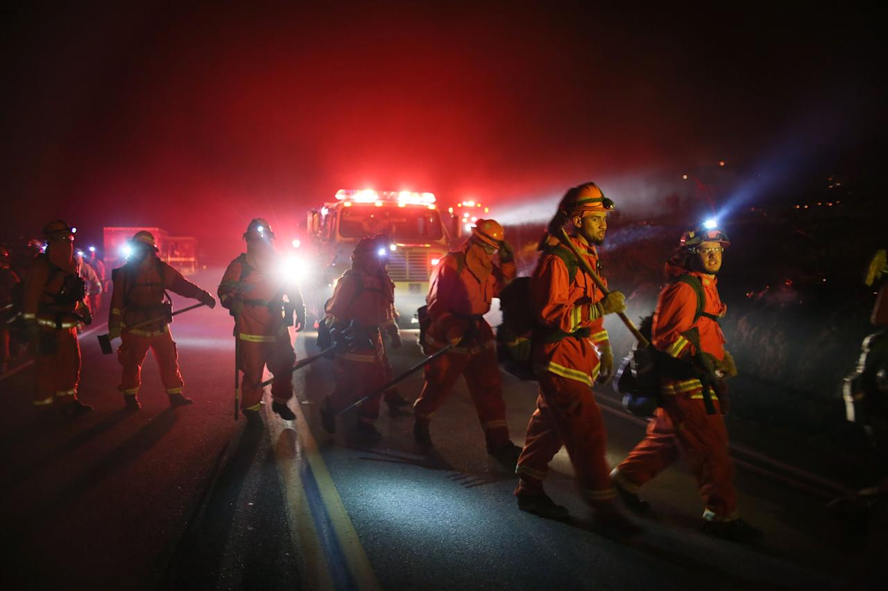 <p>Firefighters prepare to battle the Lilac fire in Bonsall, California on Thursday, Dec. 7, 2017. (Photo: Sandy Huffaker/AFP/Getty Images) </p>