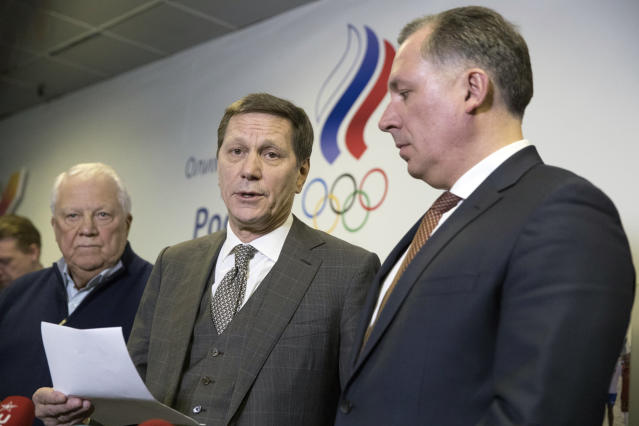 Russian Olympic Committee President Alexander Zhukov, center, Vice-President Stanislav Pozdnyakov, right, and Vitaly Smirnov, an honorary member of the International Olympic Committee, speak to the media during in Moscow, Russia, Wednesday, Feb. 28, 2018. Russias ban from the Olympic movement was lifted on Wednesday despite two failed doping tests by its athletes at the Pyeongchang Winter Olympics. The decision by the International Olympic Committee is an attempt to draw a line under the state-concocted doping scandal that tarnished the 2014 Olympics in Sochi. (AP Photo/Pavel Golovkin)