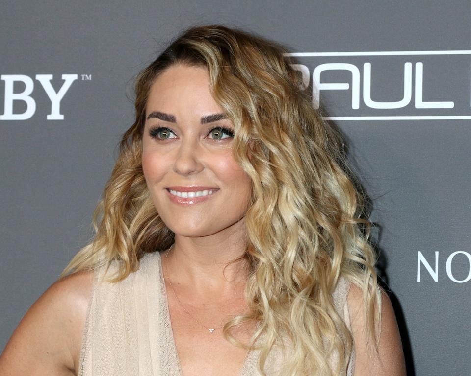 lauren conrad with curly hair on step-and-repeat