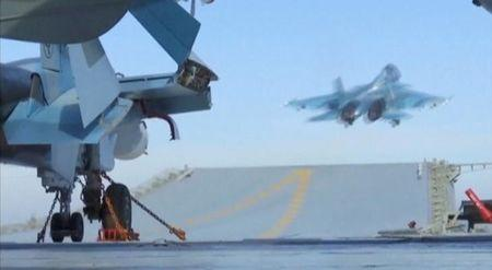 Still image shows jet taking off from Russian Admiral Kuznetsov aircraft carrier near coast of Syria
