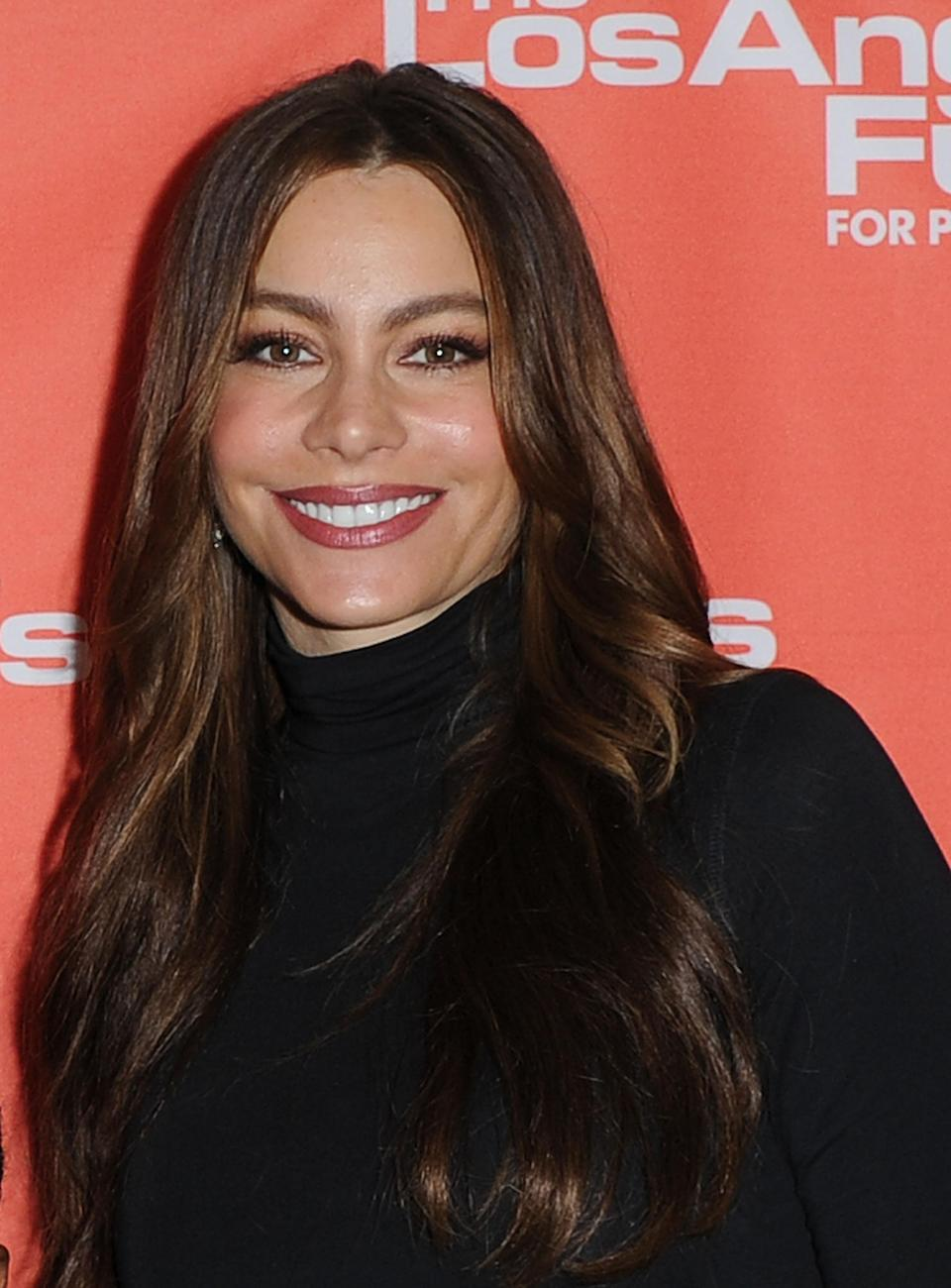 FILE - In this March 29, 2012 file photo, Sofia Vergara poses for pictures at the announcement of Food for Thought at Figueroa Elementary School, in Los Angeles. Five stars of the hit ABC series sued 20th Century Fox Television on Tuesday July 24, 2012, claiming their contracts with the studio are illegal under California law and should be invalidated. (AP Photo/Katy Winn, File)