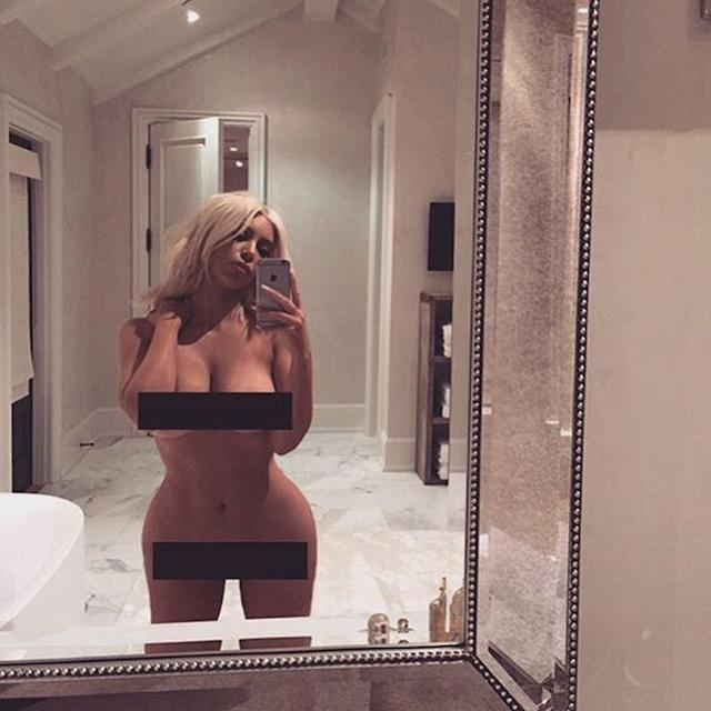 Kim Kardashian poses in front of her mirror. (Photo: Instagram)