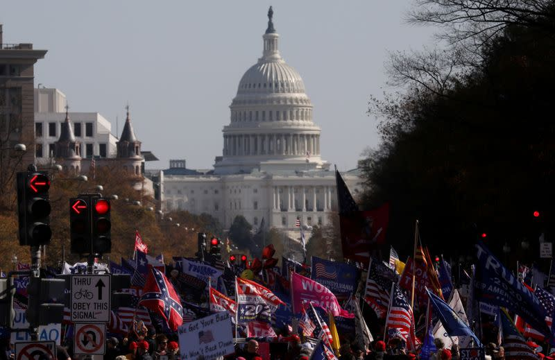 FILE PHOTO: People participate in rallies in support of U.S. President Trump in Washington, U.S.