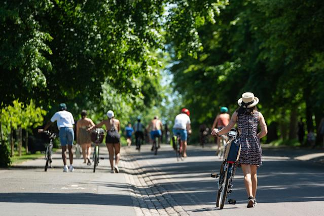 People enjoy the hot weather in Greenwich Park, London. (Getty Images)
