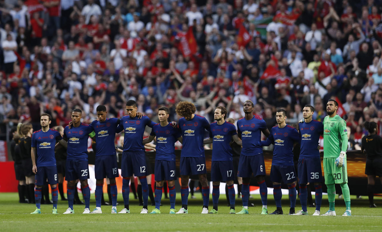<p>Manchester United players observe a minute of silence in tribute to the victims of the Manchester attack during the UEFA Europa League Final in Stockholm, Sweden on May 24, 2017. (Photo: Andrew Couldridge Livepic/Reuters) </p>