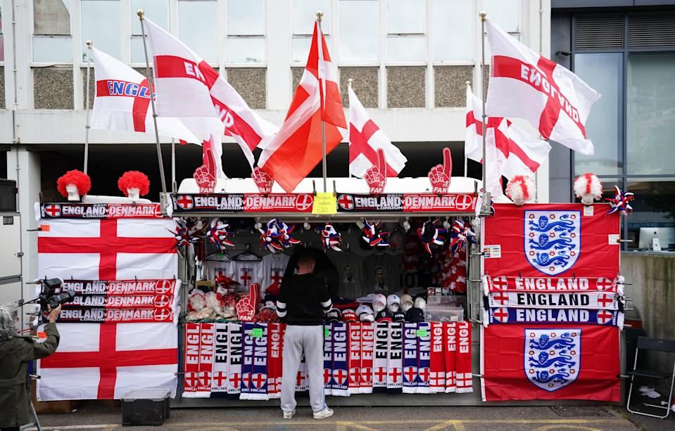 Merchandise for sale outside Wembley Stadium ahead of the Euro 2020 semi-final match between England and Denmark (PA Wire)