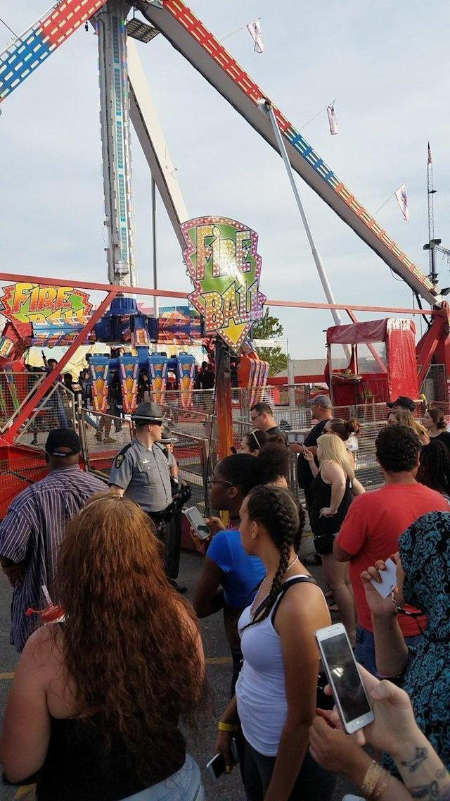 <p>People watch as authorities respond near the Fire Ball amusement ride after the ride malfunctioned injuring several at the Ohio State Fair, Wednesday, July 26, 2017, in Columbus, Ohio. Some of the victims were thrown from the ride when it malfunctioned Wednesday night, said Columbus Fire Battalion Chief Steve Martin. (Justin Eckard via AP) </p>