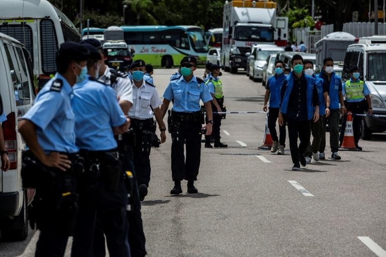 Police in Hong Kong cordoned off the street outside the Next Media offices after the arrest of media tycoon Jimmy Lai