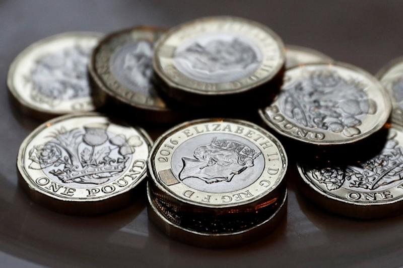 The new 12-sided £1 coin is now in circulation.(Phil Noble/Reuters)