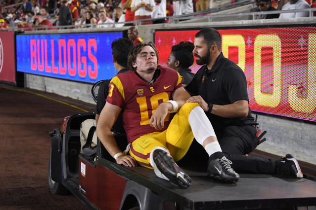 USC quarterback JT Daniels is carted off the field after being injured during the first half against Fresno State. (AP Photo/Mark J. Terrill)