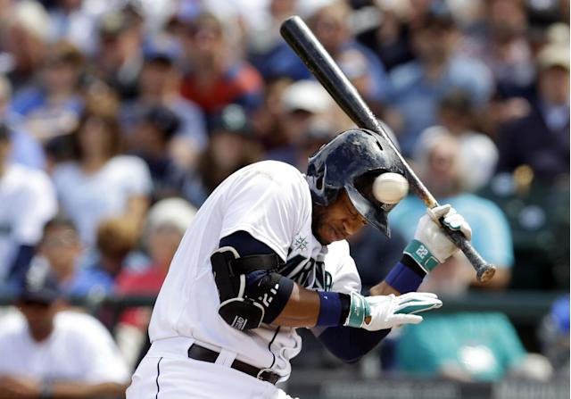 10ThingstoSeeSports - Seattle Mariners' Robinson Cano ducks a pitch that was high and inside during an at-bat in the sixth inning of a baseball game against the Cleveland Indians, Sunday, June 29, 2014, in Seattle. (AP Photo/Ted S. Warren, File)