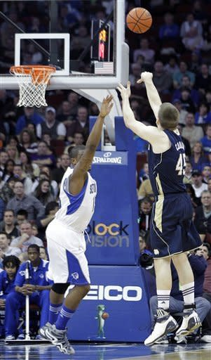 Notre Dame's Jack Cooley (45) scores Seton Hall's Herb Pope after both teams had played nearly five minutes without getting on the board at the start of an NCAA college basketball game, Wednesday, Jan. 25, 2012, in Newark, N.J. (AP Photo/Julio Cortez)