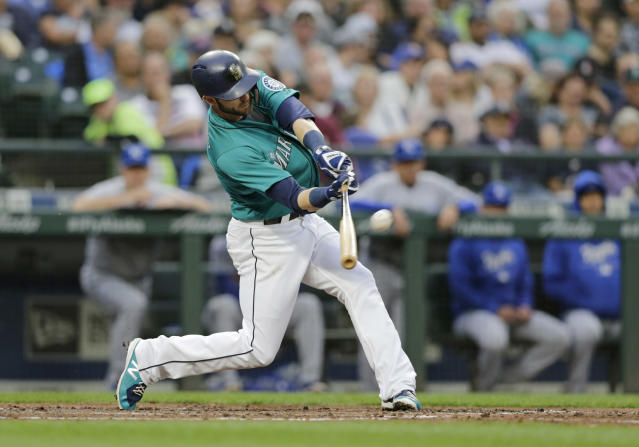 Seattle Mariners' Mitch Haniger hits a two-run home run off Kansas City Royals starting pitcher Ian Kennedy during the fourth inning of a baseball game Friday, June 29, 2018, in Seattle. (AP Photo/John Froschauer)