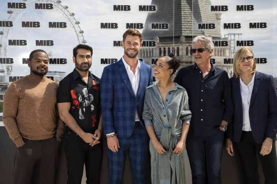 F. Gary Gray, Kumail Nanjiani, Chris Hemsworth, Tessa Thompson, Walter F.Parkes and Laurie MacDonald pose for photographers during a photo call for the film 'Men in Black: International' in London, Sunday, June 2, 2019. (Photo by Vianney Le Caer/Invision/AP)