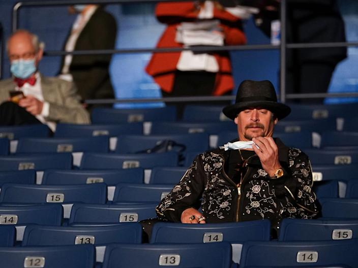 Kid Rock appeared confused by his face mask (AFP via Getty Images)