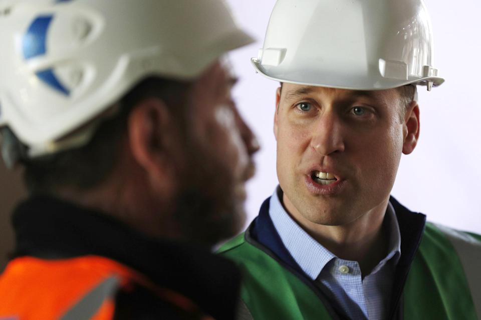 The Duke of Cambridge talks to presenter Nick Knowles as he joins the crew of DIY SOS in Ladbroke Grove, west London, on a major project to support people affected by the devastating fire at Grenfell Tower (PA)