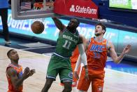 Oklahoma City Thunder's Theo Maledon, left, and Mike Muscala (33) look on as Dallas Mavericks forward Tim Hardaway Jr. (11) dunks the ball in the first half of an NBA basketball game in Dallas, Wednesday, March 3, 2021. (AP Photo/Tony Gutierrez)