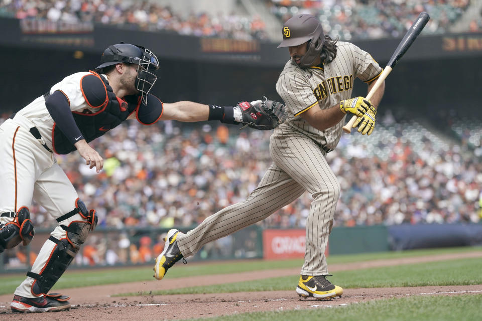 San Francisco Giants catcher Curt Casali, left, reaches to tag San Diego Padres' Nabil Crismatt after Crismatt struck out during the fourth inning of a baseball game in San Francisco, Thursday, Sept. 16, 2021. (AP Photo/Jeff Chiu)
