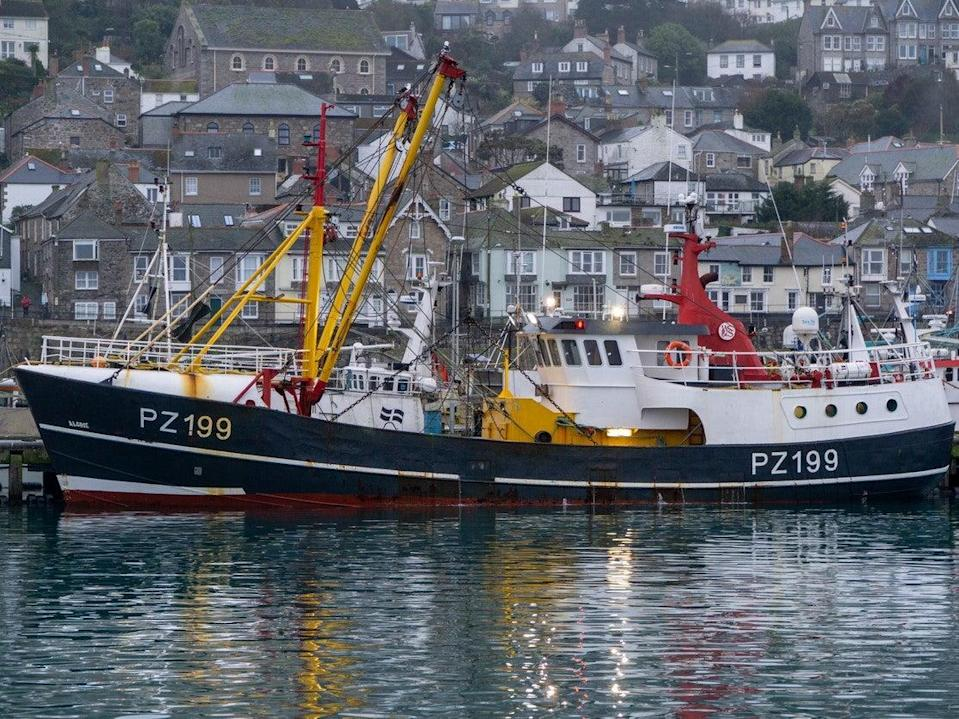 Beam trawler moored alongside the pier in Newlyn at high water (Getty Images)