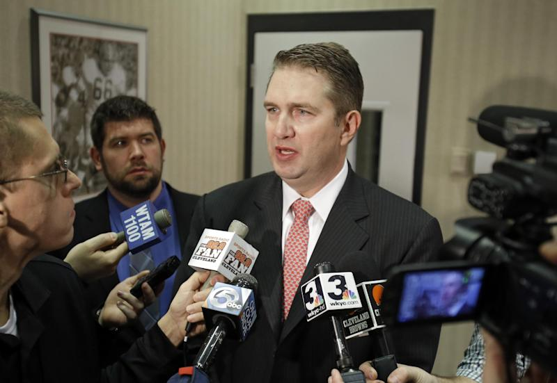 Cleveland Browns coach Rob Chudzinski talks with reporters after a news conference announcing the hiring of Mike Lombardi as vice president of player personnel at the NFL football team's practice facility in Berea, Ohio Friday, Jan. 18, 2013. (AP Photo/Mark Duncan)