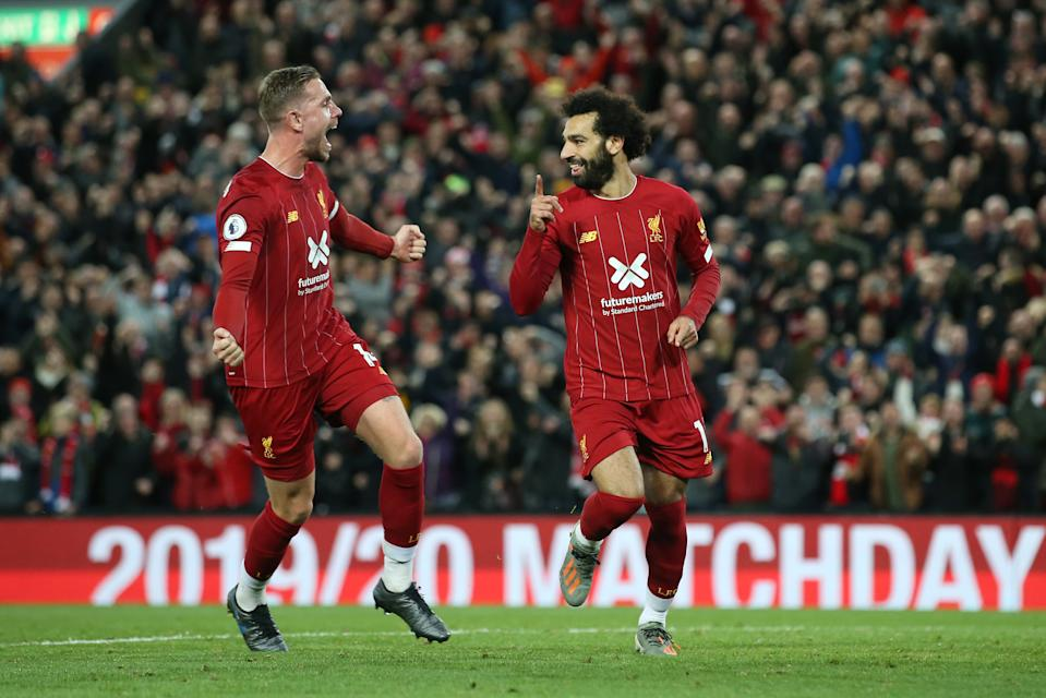LIVERPOOL, ENGLAND - OCTOBER 27:  Mohamed Salah of Liverpool (11) celebrates as he scores his team's second goal from a penalty with Jordan Henderson during the Premier League match between Liverpool FC and Tottenham Hotspur at Anfield on October 27, 2019 in Liverpool, United Kingdom. (Photo by Jan Kruger/Getty Images)