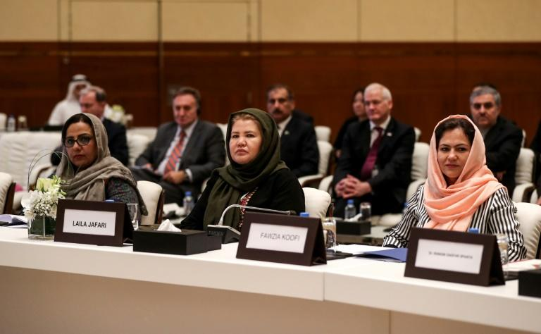 Afghan women take part in a breakthrough meeting with the Taliban in Doha
