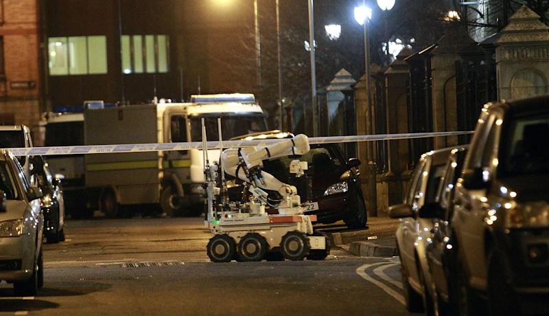 A British Army robot arrives at the scene close to a small explosion in the Cathedral Quarter in Belfast city centre, Northern Ireland, Friday, Dec. 13, 2013. Police have evacuated the area which is one of the main entertainment venues in Belfast with many bars and restaurants. It is widely believed to have been planted by Irish Republican dissident terrorists. (AP Photo/Peter Morrison)