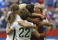 FILE - In this July 5, 2015, file photo, United States' Carli Lloyd, right, celebrates with teammates after Lloyd scored her third goal against Japan during the first half of the FIFA Women's World Cup soccer championship in Vancouver, British Columbia, Canada, Sunday, July 5, 2015. The U.S. national team, ranked No. 1 globally, will try to defend its title in soccer's premier tournament, which kicks off on June 7. (AP Photo/Elaine Thompson, File)
