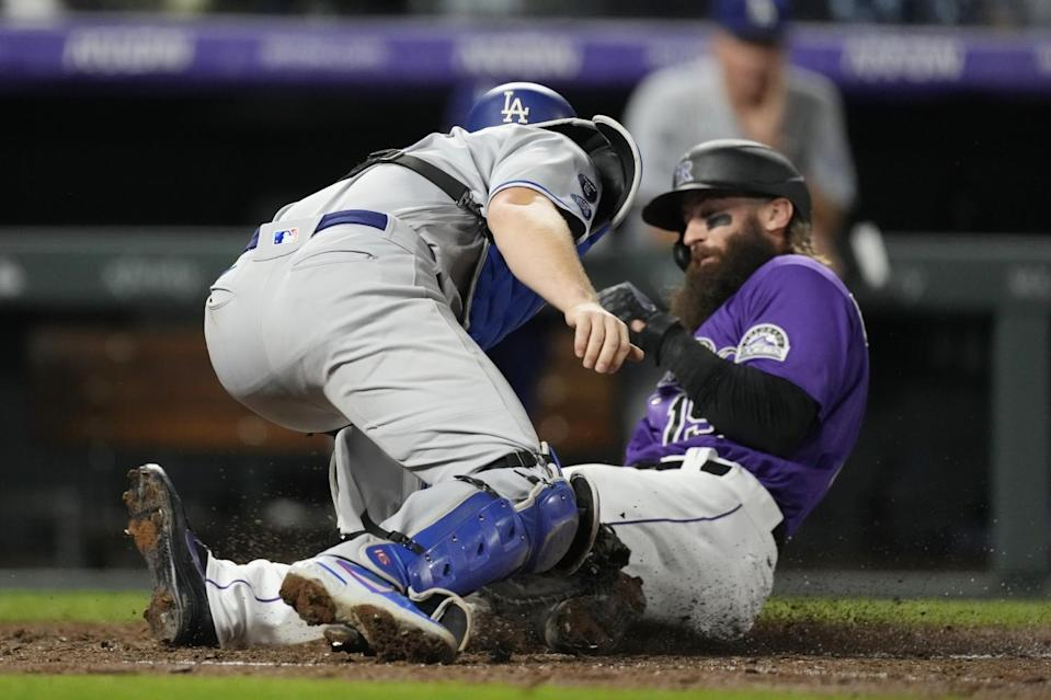 Dodgers catcher Will Smith applies a late tag as Colorado Rockies' Charlie Blackmon scores on a double hit by C.J. Cron.