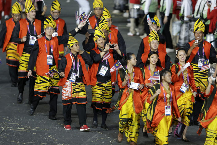 <b>Worst</b> <br> Malaysia's tiger printed yellow, orange, and black uniform was a little too bold.