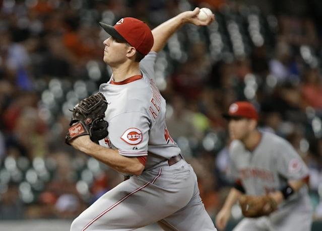Cincinnati Reds' Greg Reynolds delivers a pitch against the Houston Astros in the first inning of a baseball game Wednesday, Sept. 18, 2013, in Houston. (AP Photo/Pat Sullivan)