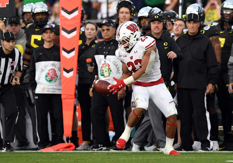 Wisconsin RB Jonathan Taylor's positional workouts at the NFL scouting combine could help ensure him being a high pick in the 2020 NFL draft. (Photo by Chris Williams/Icon Sportswire via Getty Images)