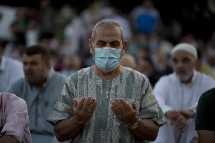 Palestinians Muslims offer Eid al-Adha prayers, in the West Bank city of Nablus, Friday, July 31, 2020. Eid al-Adha, or Feast of Sacrifice, Islam's most important holiday marks the willingness of the Prophet Ibrahim to sacrifice his son. (AP Photo/Majdi Mohammed)