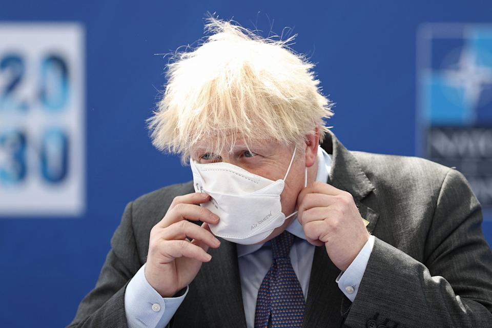 British Prime Minister Boris Johnson arrives to attend the NATO summit at the NATO headquarters in Brussels on June 14, 2021. - The allies meet to agree a statement stressing common ground on securing their withdrawal from Afghanistan, joint responses to cyber attacks and relations with a rising China. (Photo by KENZO TRIBOUILLARD / various sources / AFP) (Photo by KENZO TRIBOUILLARD/AFP via Getty Images)